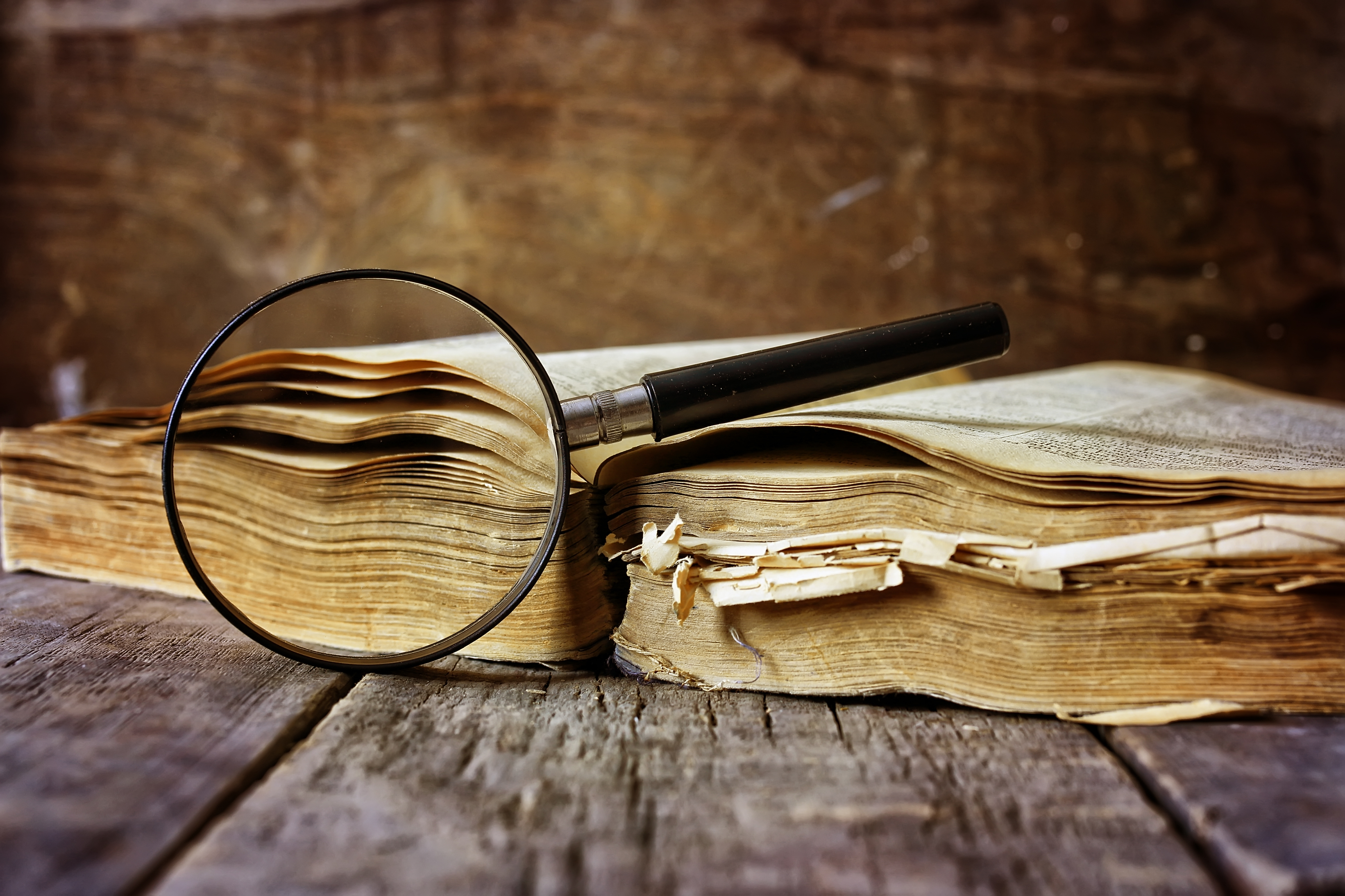 An old book and a magnifying glass
